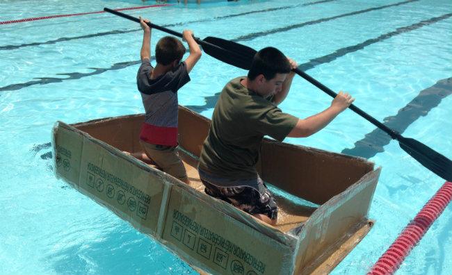 Swimming Pool Sink : Sink or swim students participate in cardboard boat regatta