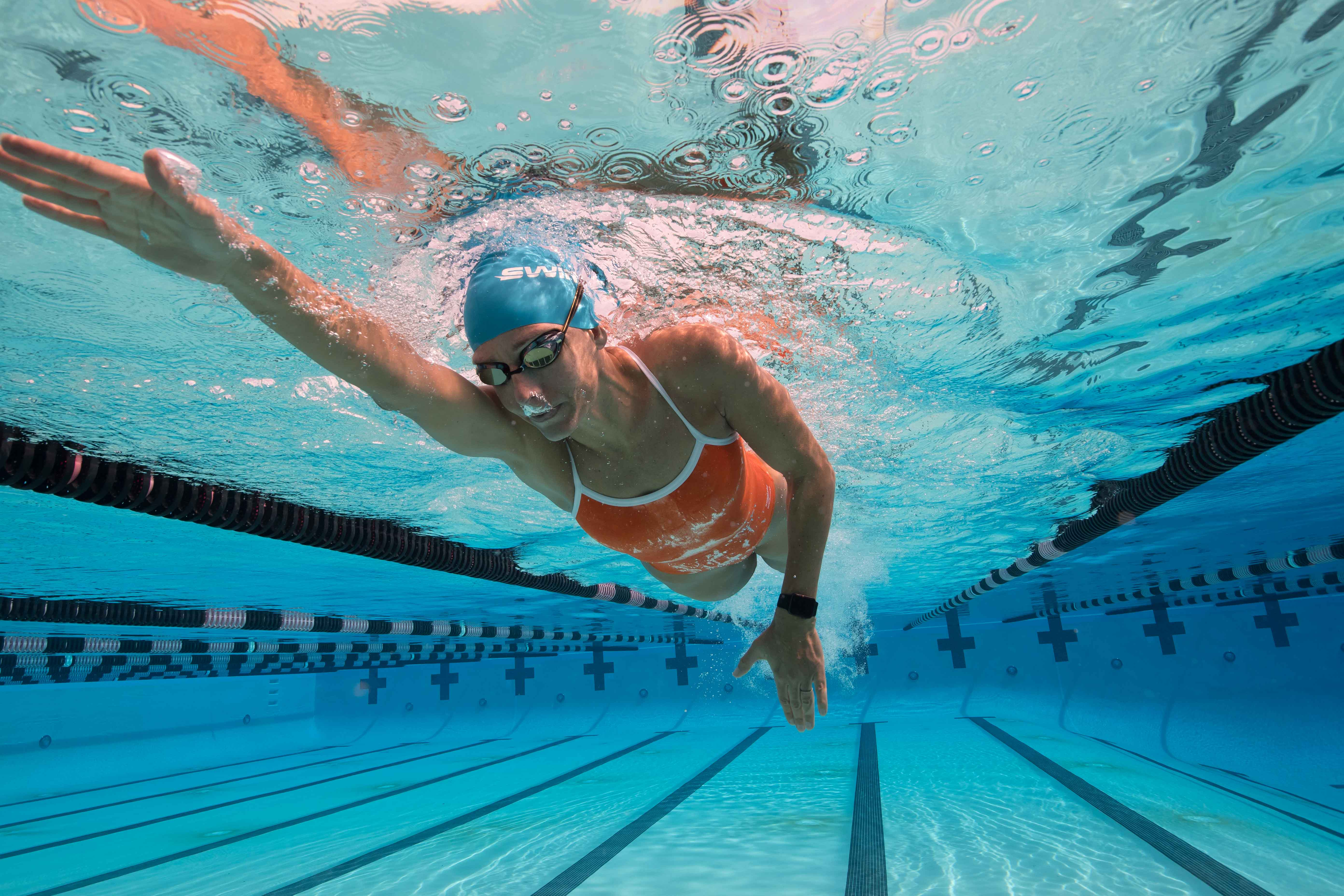 Spire swimming action shot freestyle swimmer 39 s daily for Swiming pool pic
